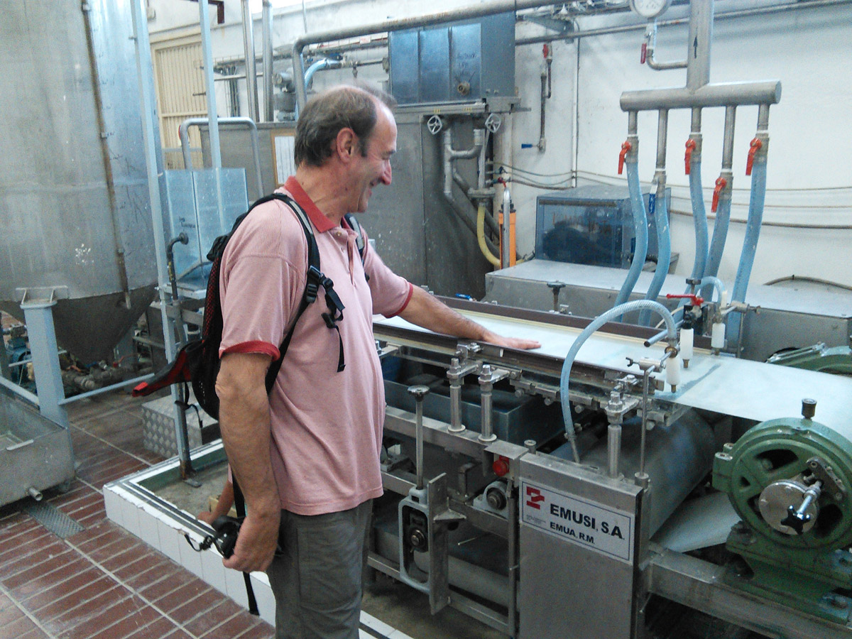 Juan explains how students operate the school's production line.