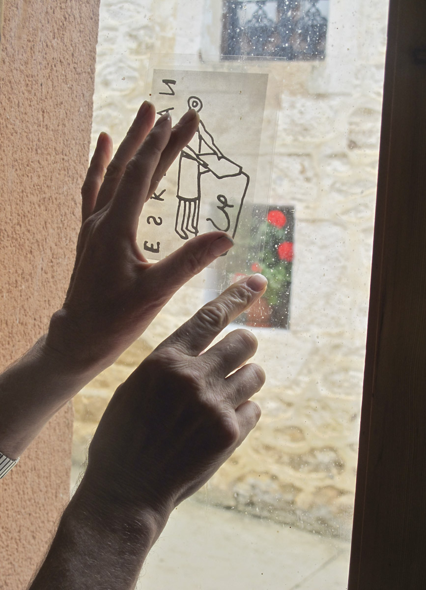 Using a window as a light table to align two photocopies on acetate. Juan Barbé photo.