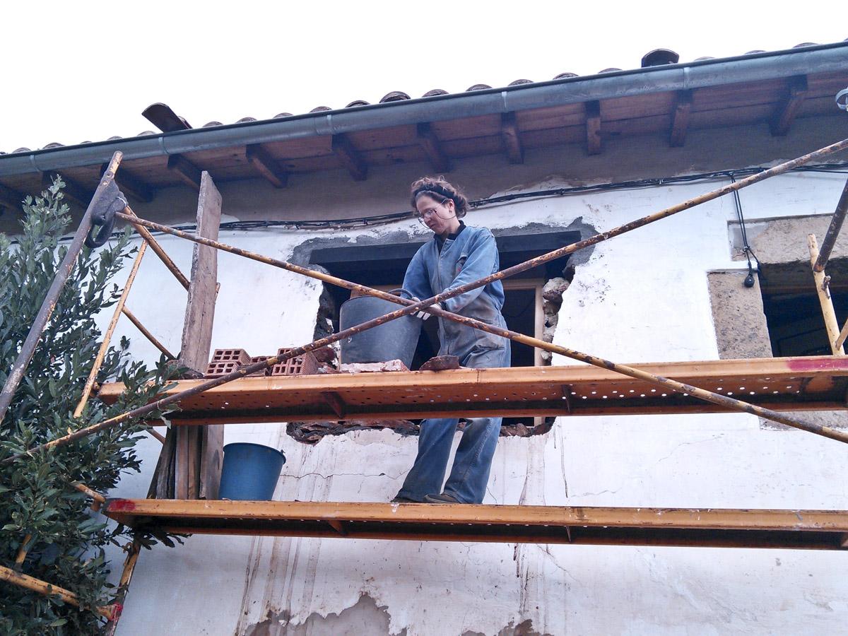 Dorien hard at work on her new windows.