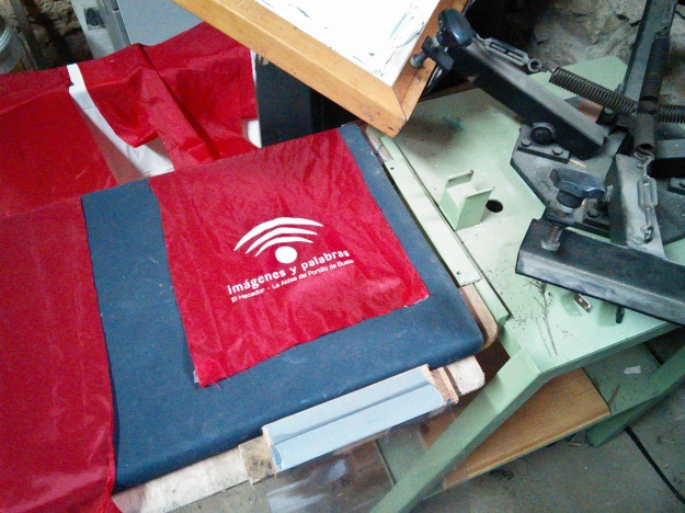 Printing scarves on the t-shirt press.