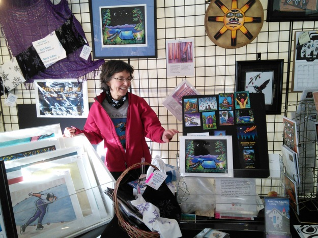 Claire in the artist market tent.