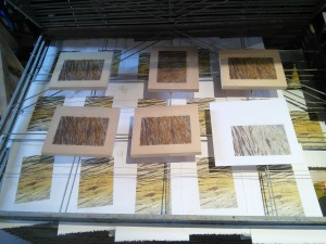 One more colour to print; paper, matte & wood blocks drying on rack.