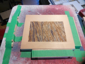 Yellow cedar block in register, freshly printed with another colour.