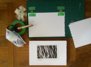 Taping paper prints with register tabs; sample film positive indicates approximate print location.