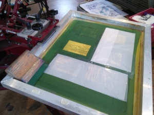 Wax paper blocks out other stencils ganged onto screen.