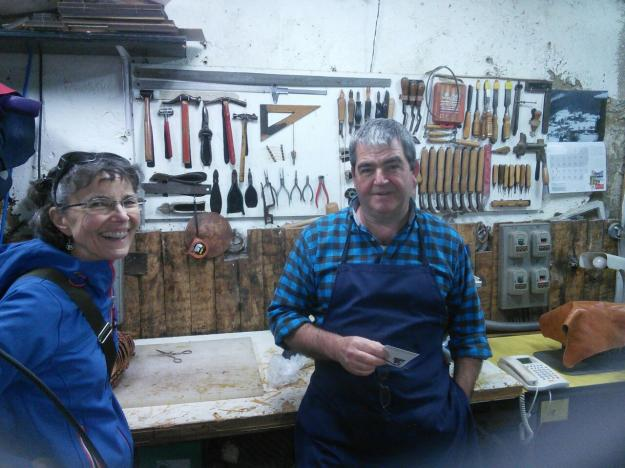 Claire with Mikel in his shop.