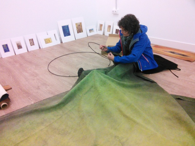 "Claire ready to attach the central fabric column of her piece ""Grove"" to Juantxo's metal rings."
