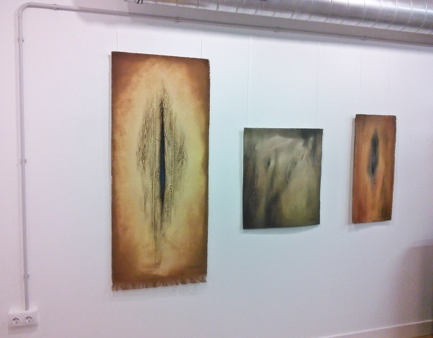 """Claire's """"Forest Carpet #4"""", """"Deferred Area"""" and """"Understory #7"""" (all mixed media on canvas)."""